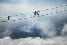 Tourist Walking On Rope Bridge...