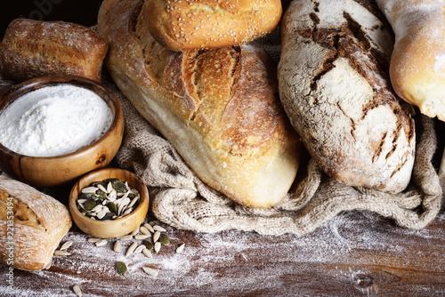 Fotografie, Obraz Assorted bread on wood background