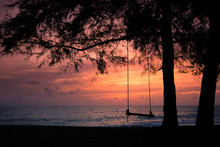 The Silhouette Of A Swing Background Image. At Mai Khao Beach, Phuket, Thailand