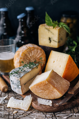 Several types of cheese and beer