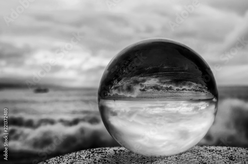 Fotografie, Obraz  Black and White Stormy Surf and Sky Through Glass Ball