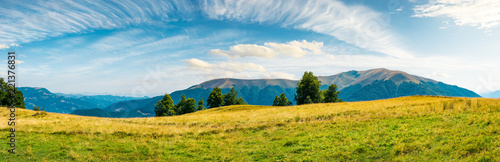 Fotobehang Wit great panorama of mountainous landscape. gorgeous cloudscape above wide grassy meadow. mountain ridge with alpine meadows in the distance. wonderful sunny day and good weather for outdoor activities