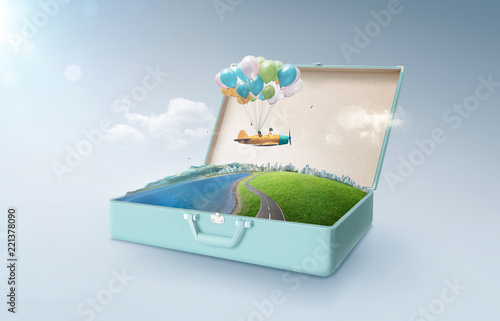 Photo Happy sister enjoy with fantasy colorful balloons plane fly and floating in an open retro vintage suitcase isolated on light blue background