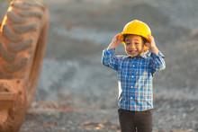 Little Boy Wearing A Helmet, D...
