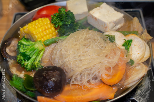 Fotografie, Obraz  Selective focus on rice noodles of Tawanese vegetarian boiling pot ready to eat,