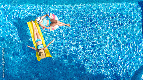 Aerial drone view of children in swimming pool from above, happy kids swim on in Wallpaper Mural