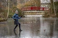 Woman On Frozen Pond In Winter