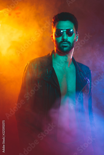 Fotografie, Tablou  Portrait of young man in leather jacket and sunglasses