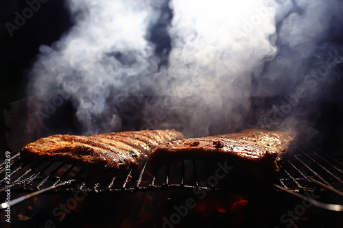 Cuadros en Lienzo pork ribs on the grill cooking coals / fresh meat pork cooked on charcoal, summe