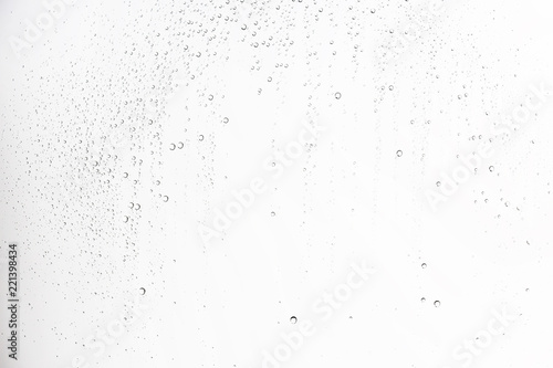 Fototapeta white isolated background water drops on the glass / wet window glass with splashes and drops of water and lime, texture autumn background obraz