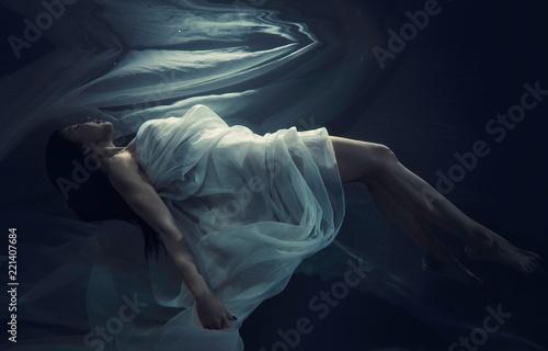 Fototapeta  Beautiful woman swimming with fancy dress underwater
