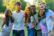 canvas print picture - Group of teens playing with colors at the holi festival, in a park