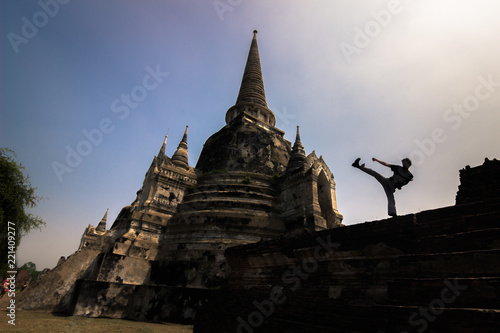Ayutthaya - October 15, 2014: Display of Martial arts in the temple of Wat Phra Sri Sanphet in the historic city of Ayutthaya, Thailand