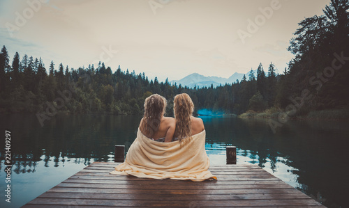 Young couple having fun at the lake in the morning