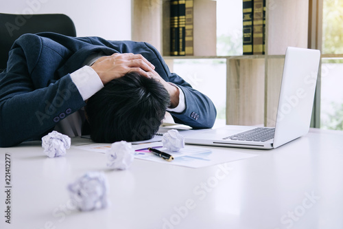Fotografie, Obraz Feeling stress and headache, Businessman depressed and exhausted at his desk fru