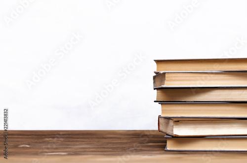 Fotografie, Obraz  Stack of books on the school desk isolated on white background.