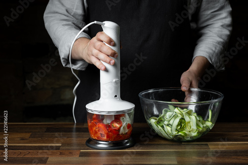 Fotografie, Obraz  Chef mixing and cooking tomato traditional sauce in blender for vegetables diet salad