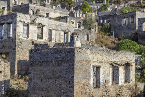 Poster Oude gebouw Ancient masonry rocky houses of an old village in Turkey founded by old Greeks