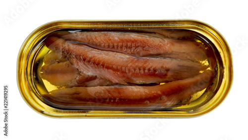 Photo Fillet of anchovies with oil in a yellow oval tin can, close up, top view, isola