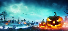 Jack O Lanterns And Zombie Hands Rising Out Of A Graveyard In Misty Night