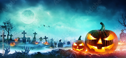Spoed Foto op Canvas Turkoois Jack O Lanterns And Zombie Hands Rising Out Of A Graveyard In Misty Night