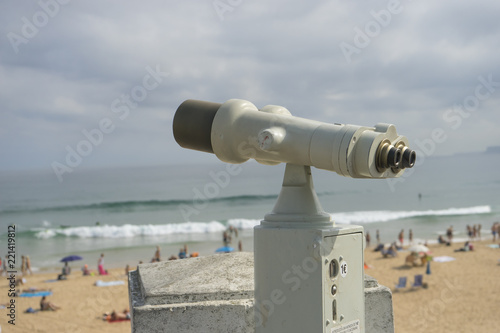 Poster Donkergrijs Coin operated binocular on the summer beach, tourist scene in Spain