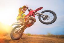Motocross Rider Doing A Wheelie