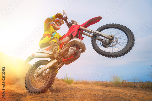 Photo  Motocross rider doing a wheelie