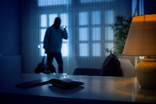 Burglar Or Intruder Inside Of A House