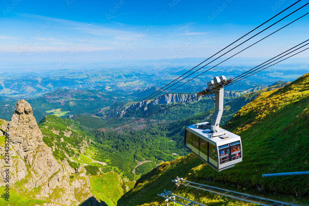 Fototapety, obrazy: cable car on the ropes, going to Mount Kasprowy Wierch, Poland. Beautiful view of the valley