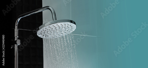 Close up of Water flowing from shower in the bathroom interior