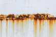 canvas print picture - Corrosion of welding seam with red stains on a old white metal sheet. Abstract background