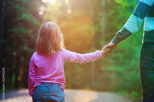 Fotografia, Obraz  Mother holding hand of little daughter in nature