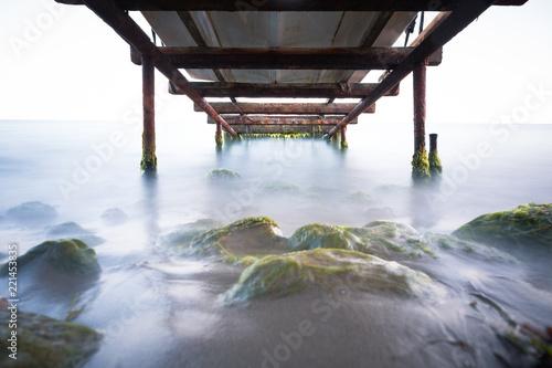 Photographie  Long Exposure under the Beach Pier.