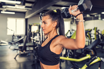 Young woman workout in gym ...