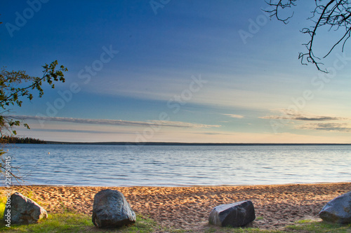 Rocks on the edge of a beach in morning light Canvas Print
