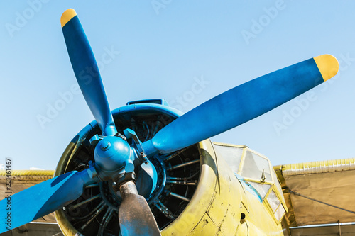 Fotografija  engine, fuselage and propeller of the airplane against the blue sky