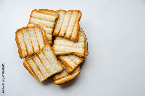 Deurstickers Brood Bread baked on the grill lies ona plate on a white background. Top view.