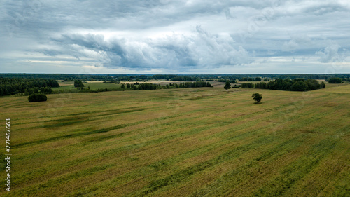 Spoed Foto op Canvas Bleke violet drone image. aerial view of rural area with fields and forests under dramatic storm clouds forming