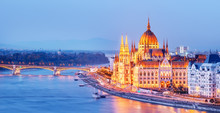 Budapest, Hungary. Night View On Parliament Over Delta Of Danube River.