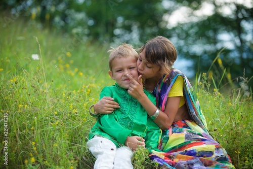 Photo  A lot of small children, boys and girls, dressed in the clothing culture of India