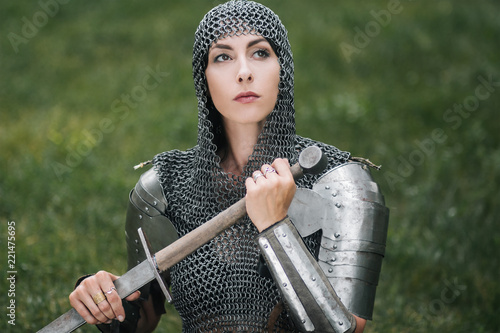 Cuadros en Lienzo Medieval girl warrior, in a chain mail hood with a sword in his hand