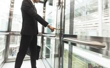 Man Pressing Elevator Button. Finger Presses Elevator Button. Businessman In Lift
