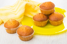 Striped Napkin, Small Muffins In Yellow Plate And On Table