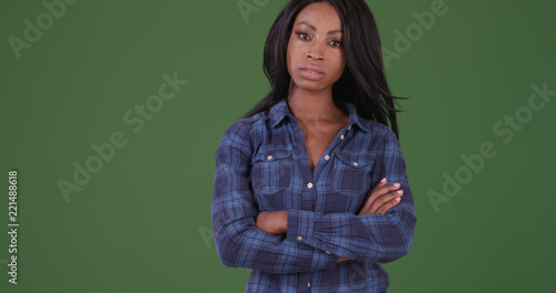 Stern black woman looking at camera with arms crossed on