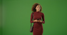 Young Black Female With Smartphone Standing On Green Screen