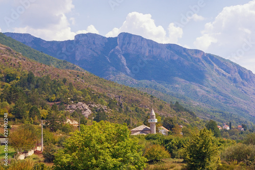 Picturesque mountain landscape, summer. Bosnia and Herzegovina, Trebinje, view of Mosque in Zupa