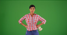 Black Woman Gardener In Plaid Shirt Posing With Hands At Hips On Green Screen