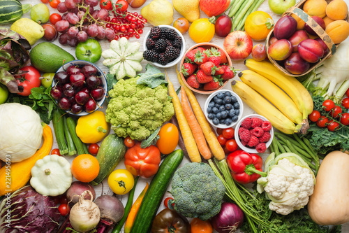 Fototapeta Healthy fruits vegetables berries background, cherries peaches strawberries cabbage broccoli cauliflower squash tomatoes carrots bananas beans beetroot, pepper, top view, selective focus obraz