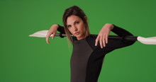 Confident Woman In Wetsuit Holding Kayak Paddle Over Shoulders On Green Screen